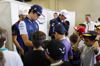 Lance Stroll, Williams Racing, signs autographs for young fans
