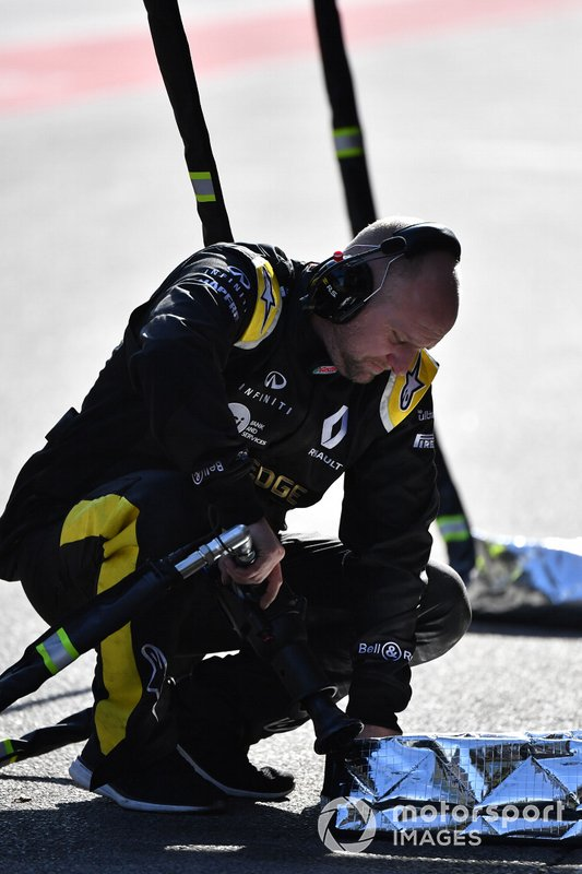 Renault Sport F1 Team mechanic with wheel gun