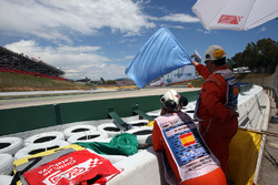 Marshals wave the blue flag