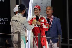 Nico Rosberg, Mercedes AMG F1 celebrates his World Championship on the podium with Sebastian Vettel, Ferrari.