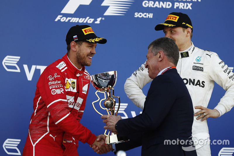 Dmitry Kozak, Deputy Prime Minister of the Russian Federation presents the second place trophy to Sebastian Vettel, Ferrari
