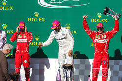 Third place Kimi Raikkonen, Ferrari celebrates on the podium with former US President Bill Clinton, second place Sebastian Vettel, Ferrari, winner Lewis Hamilton, Mercedes AMG F1 and the trophy
