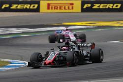 Romain Grosjean, Haas F1 Team VF-18, leads Sergio Perez, Force India VJM11