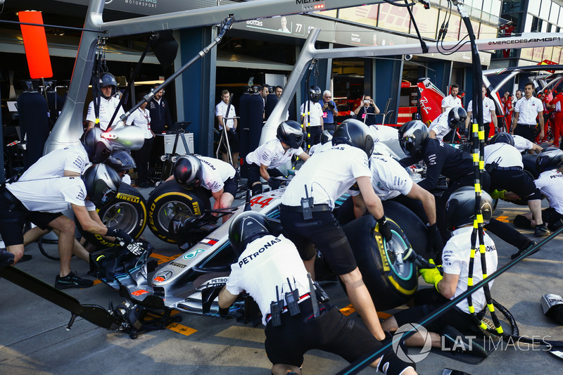 The Mercedes team practice their pit stops