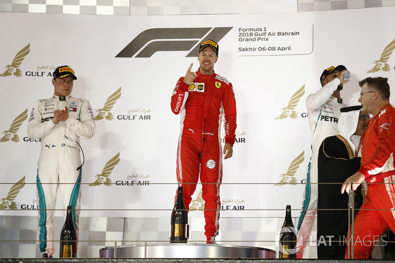 Valtteri Bottas, Mercedes AMG F1, 2nd position, Sebastian Vettel, Ferrari, 1st position, and Lewis H
