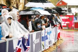 Fans wait in the rain for an autograph