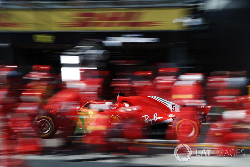 Sebastian Vettel, Ferrari SF71H, makes a pit stop
