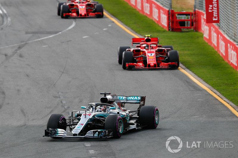 Lewis Hamilton, Mercedes AMG F1 W09, leadsSebastian Vettel, Ferrari SF71H, and Kimi Raikkonen, Ferra