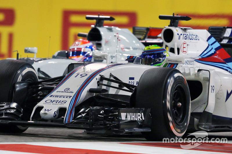 Felipe Massa, FW38 Williams y Romain Grosjean, Batalla de equipo de F1 de Haas VF-16 para la posición