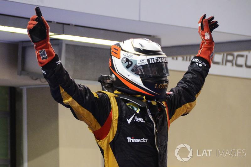 Ganador de la carrera Kimi Raikkonen, Lotus F1 celebra en parc ferme