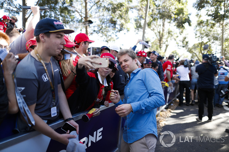 Nico Rosberg poses for a picture for fans