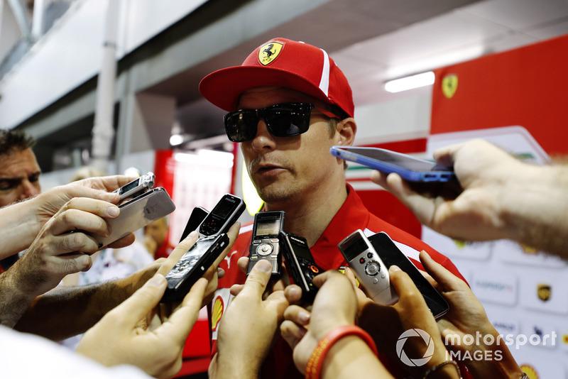 Kimi Raikkonen, Ferrari, talks to the media