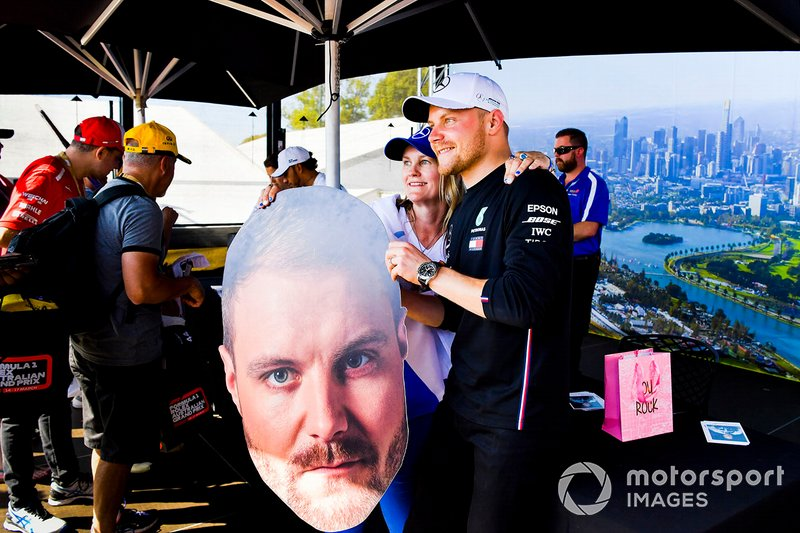 Valtteri Bottas, Mercedes AMG F1 poses for a photograph with a fan