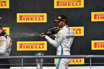 Lewis Hamilton, Mercedes AMG F1 celebrates with the champagne on the podium with the trophy
