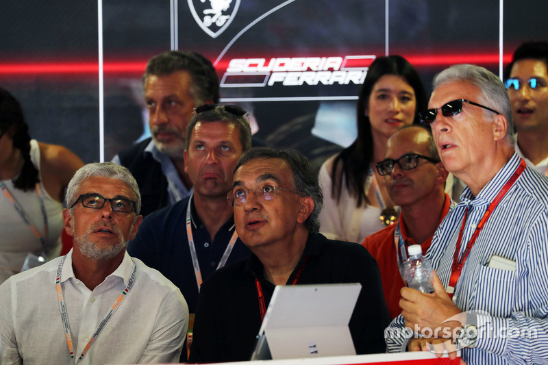 Sergio Marchionne, Ferrari President and CEO of Fiat Chrysler Automobiles (Centre) and Piero Ferrari, Ferrari Vice-President (Right) watch qualifying
