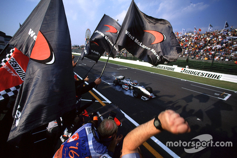 Checkered flag for Mika Hakkinen, McLaren