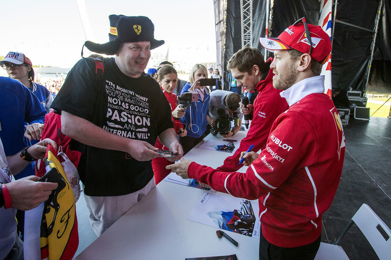 Sebastian Vettel, Ferrari signs autographs for the fans at the autograph session
