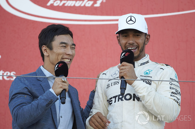 Takuma Sato interviews Race winner Lewis Hamilton, Mercedes AMG F1, on the podium