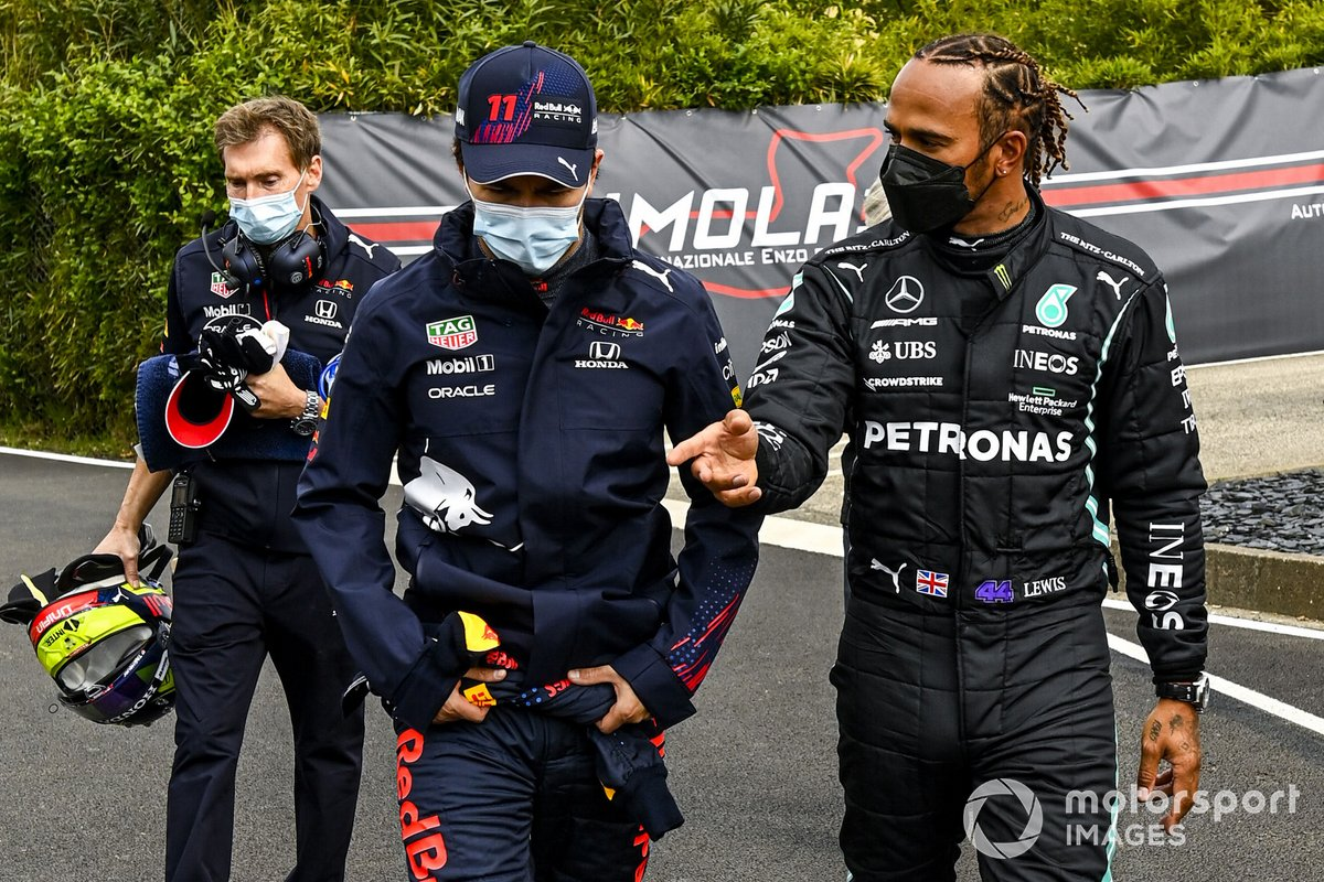 Sergio Perez, Red Bull Racing and Polesitter Lewis Hamilton, Mercedes walk to the Press Conference