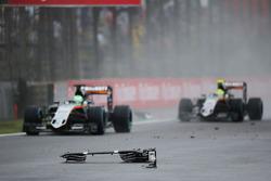 Nico Hulkenberg, Sahara Force India F1 VJM09 and Sergio Perez, Sahara Force India F1 VJM09 pass debris from the Sauber C35 of Marcus Ericsson, Sauber F1 Team