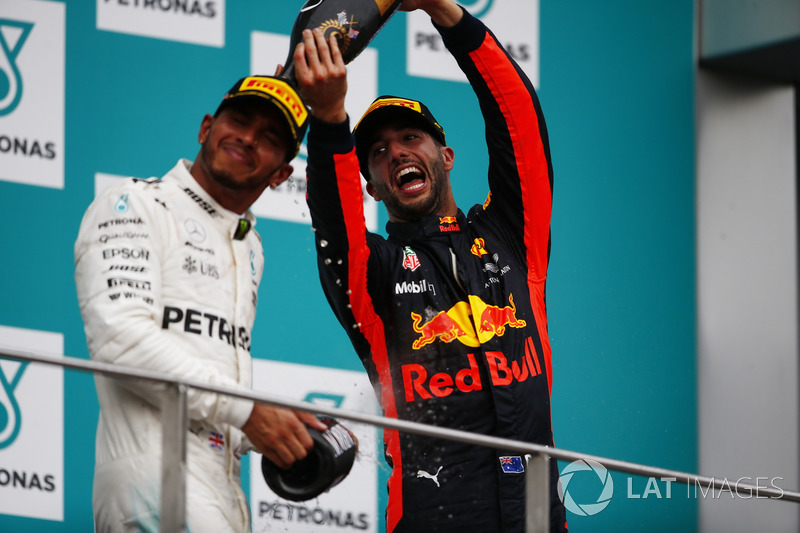 third place Daniel Ricciardo, Red Bull Racing, pours Champagne over second place Lewis Hamilton, Mercedes AMG F1, on the podium
