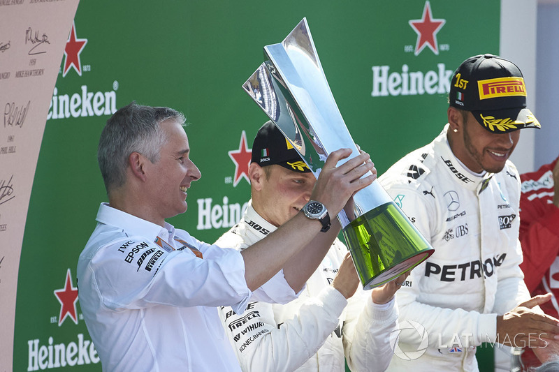Second place Valtteri Bottas, Mercedes AMG F1, Race winner Lewis Hamilton, Mercedes AMG F1, applaud as the Constructors trophy is presented