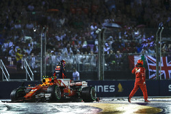 Kimi Raikkonen, Ferrari SF70H, Max Verstappen, Red Bull Racing RB13, climb out of their damaged cars
