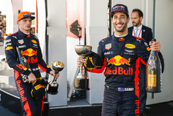 Max Verstappen, Red Bull, second place, Third place Daniel Ricciardo, Red Bull Racing, with their trophies