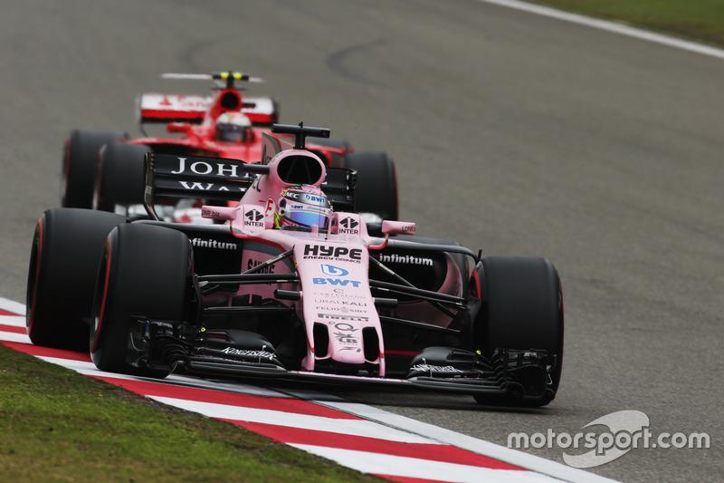 Sergio Perez, Force India VJM10, leads Kimi Raikkonen, Ferrari SF70H