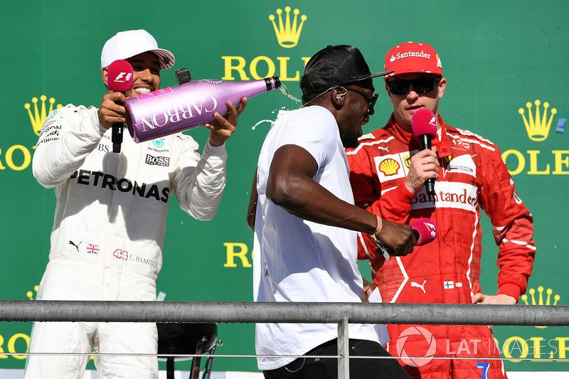 Race winner Lewis Hamilton, Mercedes AMG F1 celebrates on the podium with the champagne and Usain Bolt, third place Kimi Raikkonen, Ferrari