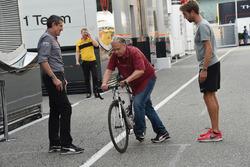 Gene Haas, Founder and Chairman, Haas F1 Team on a bike