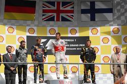 Podium: race winner Jenson Button, McLaren, second place Sebastian Vettel, Red Bull Racing, third place Kimi Raikkonen, Lotus F1