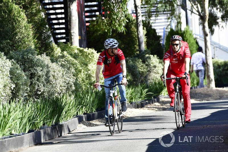 Sebastian Vettel, Ferrari on a bike with his trainer Antti Kontsas