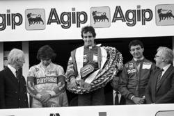 Podio: il vincitore della gara Alain Prost, McLaren, il secondo classificato Michele Alboreto, Ferrari, il terzo classificato Nelson Piquet, Brabham
