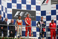 Podium: race winner Kimi Raikkonen, Ferrari, second place Giancarlo Fisichella, Force India F1, thir