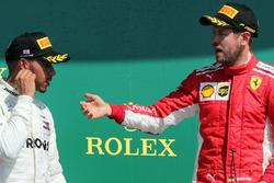 Sebastian Vettel, Ferrari and Lewis Hamilton, Mercedes AMG F1 on the podium