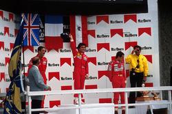 Подиум: победитель гонки Ален Прост, второе место – Найджел Мэнселл, третье место – Герхард Бергер