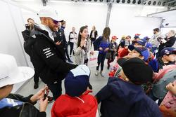 Lewis Hamilton, Mercedes AMG F1, signs autographs for kids