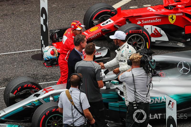 Sebastian Vettel, Ferrari and Lewis Hamilton, Mercedes AMG F1 celebrate in parc ferme alongside David Coulthard, Channel Four TV Commentator and Jenson Button (GBR)