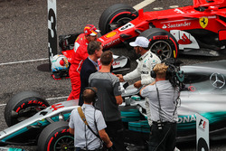 Sebastian Vettel, Ferrari and Lewis Hamilton, Mercedes AMG F1 celebrate in parc ferme alongside David Coulthard, Channel Four TV Commentator and Jenson Button (GBR)