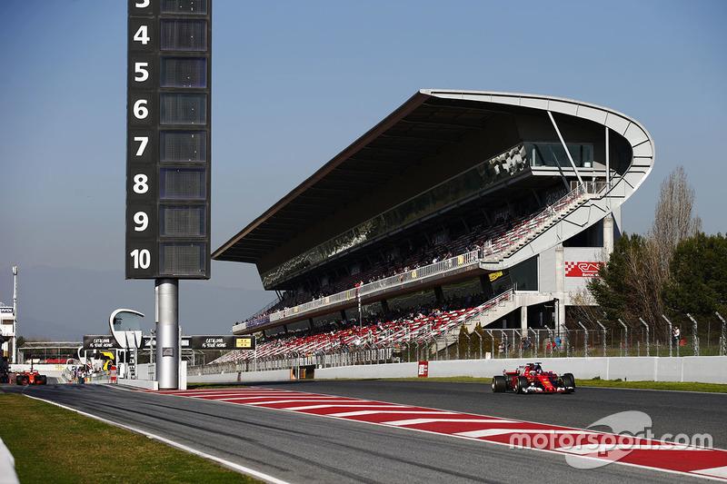 Kimi Raikkonen, Ferrari SF70H passes Carlos Sainz Jr., Scuderia Toro Rosso STR12, as Fernando Alonso, McLaren MCL32 exits the pit lane