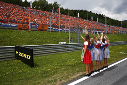 Grid Girls wave to the crowds