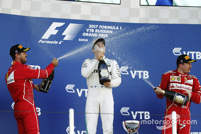 Podium: race winner Valtteri Bottas, Mercedes AMG F1, second place Sebastian Vettel, Ferrari, third