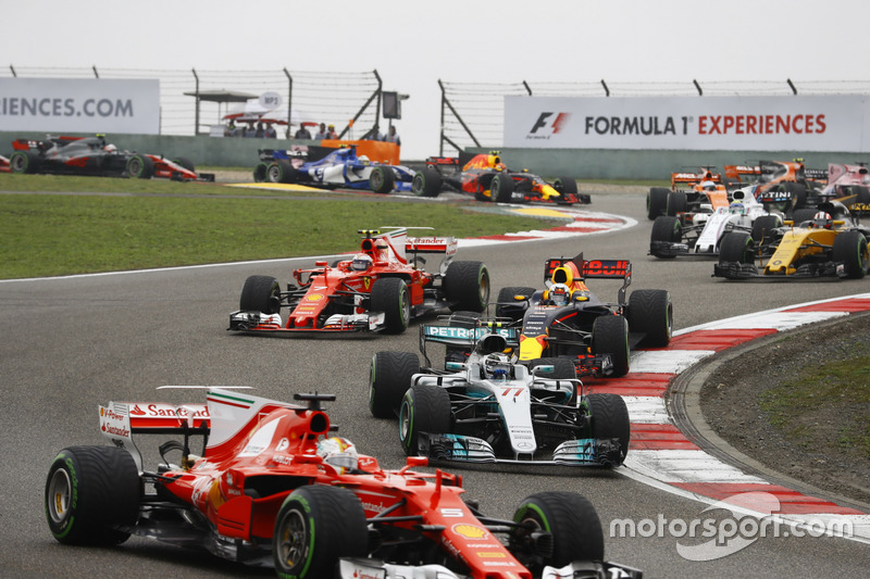 Sebastian Vettel, Ferrari SF70H, leads Valtteri Bottas, Mercedes AMG F1 W08, Daniel Ricciardo, Red Bull Racing RB13, Kimi Raikkonen, Ferrari SF70H