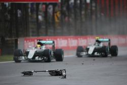 Lewis Hamilton, Mercedes AMG F1 W07 Hybrid and team mate Nico Rosberg, Mercedes AMG F1 W07 Hybrid pass debris from the Sauber C35 of Marcus Ericsson, Sauber F1 Team
