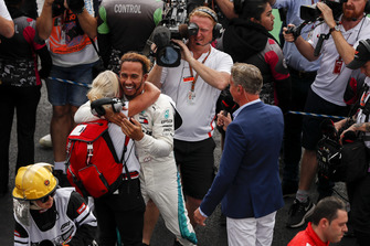 Lewis Hamilton, Mercedes AMG F1, embraces trainer Angela Cullen after securing his 5th world drivers championship title