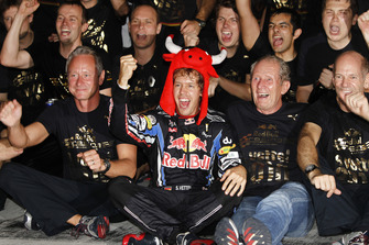 Sebastian Vettel, Red Bull Racing RB6, Helmut Marko, Consultant, Red Bull, Adrian Newey, Chief Technical Officer, Red Bull Racing, and the Red Bull team celebrate their championship victories.