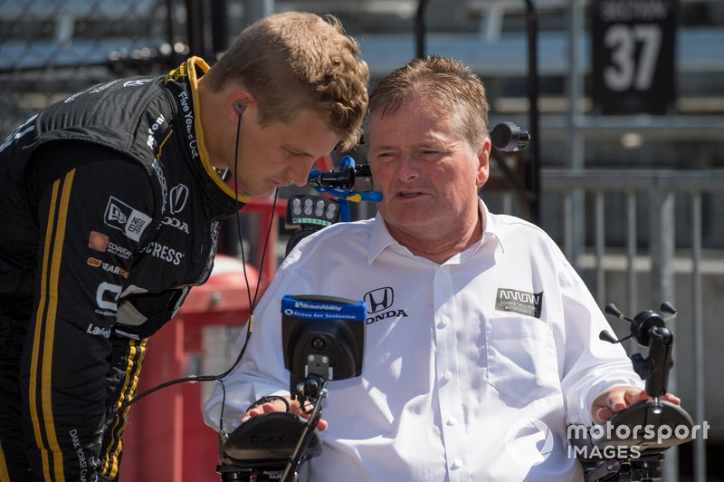 Marcus Ericsson listens to team co-owner Sam Schmidt.