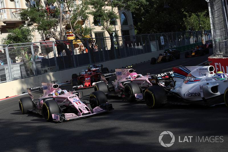 Sergio Perez, Sahara Force India VJM10 and Esteban Ocon, Sahara Force India VJM10 at the restart