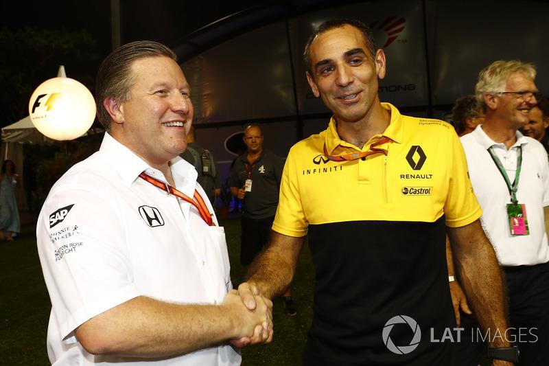 Zak Brown, Executive Director, McLaren Technology Group, Cyril Abiteboul, Managing Director, Renault Sport F1 Team, shake hands in the paddock